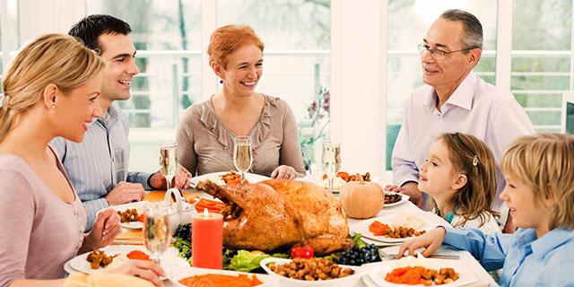 happy family having Thanksgiving dinner